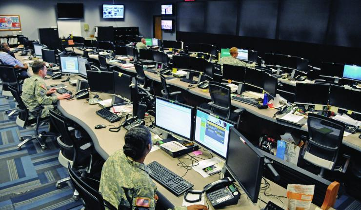 Uniformed and civilian cyber and military intelligence specialists monitor Army networks in the Cyber Mission Unit's Cyber Operations Center at Fort Gordon, Ga. (Photo by Michael L. Lewis)